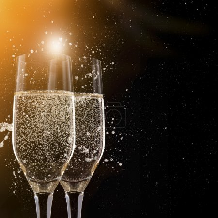 Photo for Champagne flutes on black background, celebration theme. - Royalty Free Image