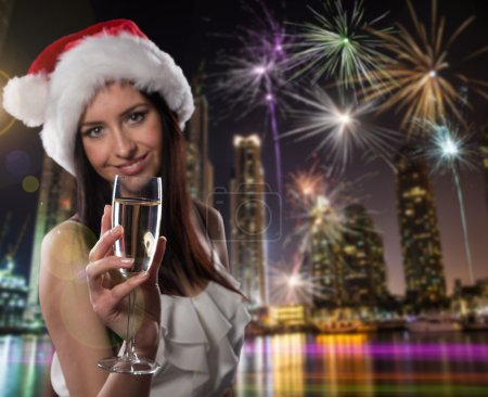 Young Santa girl with champagne glass