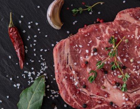 Raw beef steak onblack table
