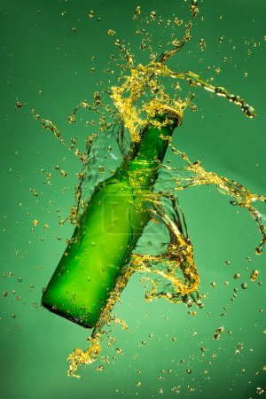 Green beer bottle with splashing liquid