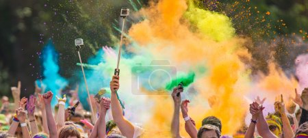 people covered with colored powder.