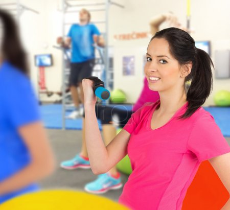 Woman training in a fitness club