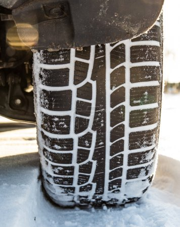 Winter tire on car, close-up.