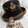 Traditional Bolivian golden jewelry with Boliviani...
