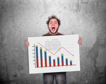Photo for Crazy businessman holding poster with decreasing chart - Royalty Free Image