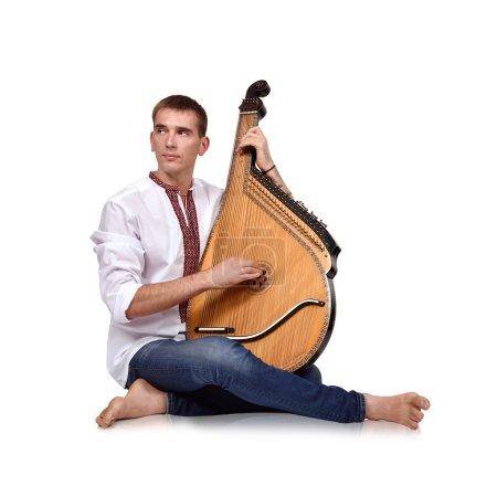 Kobzar singing to his own accompaniment on bandura