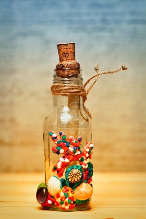 An old bottle with a note, decorated with seashells, modern art handmade. work of art handmadebung, bottle, cork, note, rope, vintage, message, inside, old, pirate, marine, cord, lace, string, braid, tie, twine, line, lashing, handmade, sea, water, g