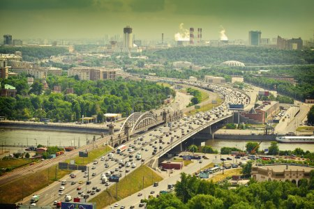 Moscow - city landscape. Road with cars at rush hour. The Third Ring Road. Life of the big city. Moscow river