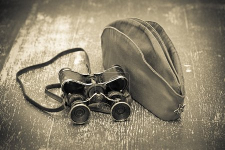 Victory Day on May 9. Vintage military binoculars and a field cap