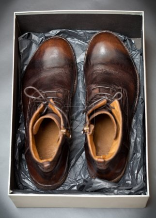 Expensive men's fashion leather shoes in a box from a store