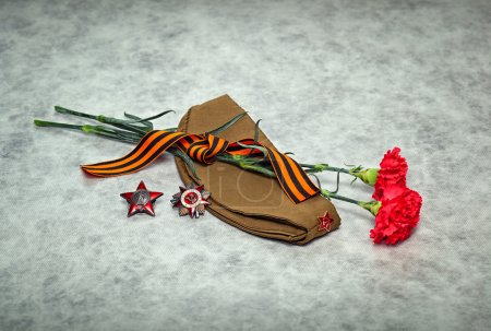 Carnation flowers, George Ribbon, forage cap, orders and medals. Victory Day - May 9.