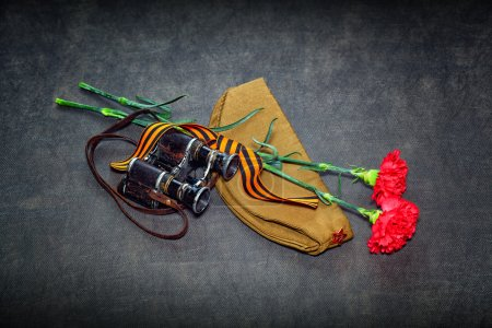 Carnation, George Ribbon, military binoculars and field cap. 70 Years of Victory in the Great Patriotic War