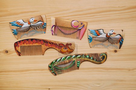 Wooden comb for hair in the form of a giraffe, duck, elephant and dinosaur. Handmade, hand-painted, piece goods.