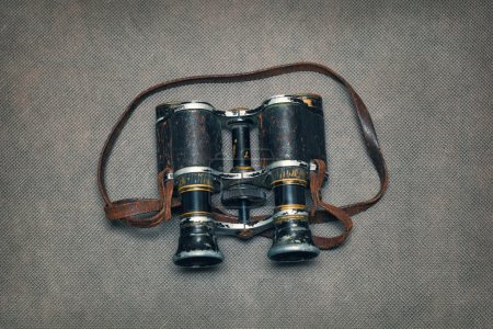Old vintage binoculars on a dark background
