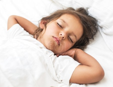 Photo for Sleeping kid girl in the bed. - Royalty Free Image