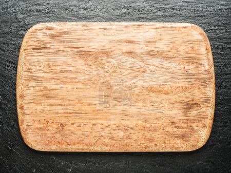 Photo for Empty chopping wooden board on the graphite background. - Royalty Free Image