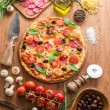 Pizza with mushrooms, salami and tomatoes. Top vie...