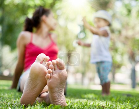 Mother and little daughter have a rest in the park.