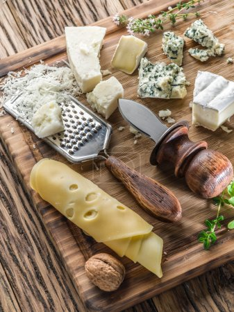 Photo for Different types of cheeses with nuts and herbs. Top view. - Royalty Free Image