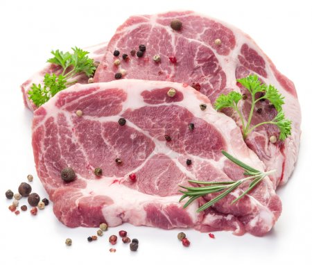 Photo for Raw pork meat steaks with spices on the white background. - Royalty Free Image