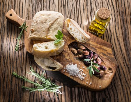 Photo for Ciabatta, olives and blue cheese on the wood. - Royalty Free Image