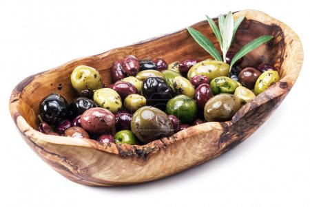 Whole table olives in the wooden bowl on the white background.