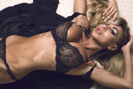 Blonde model in lingerie posing