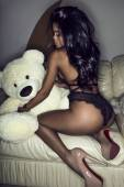 Mulatto in lingerie with teddy bear