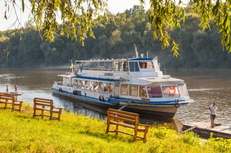 Tourist boat on the Desna river bank
