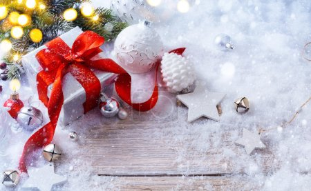 Photo for Christmas gift box on snow background and holidays light - Royalty Free Image