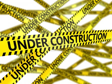 yellow tape with under construction sign