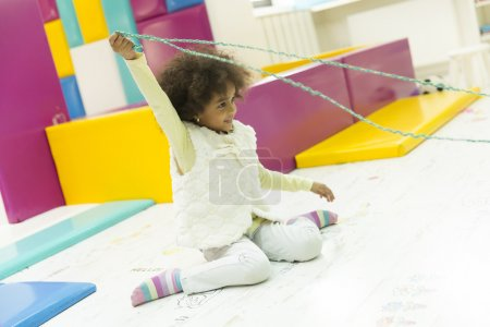 Little african girl at the playroom