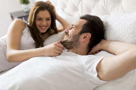 Young couple in the bed