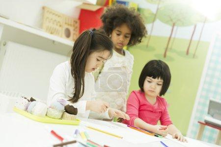 Little girls in the kindergarden