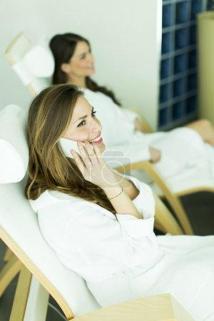Two women in bathrobes relaxing in the spa