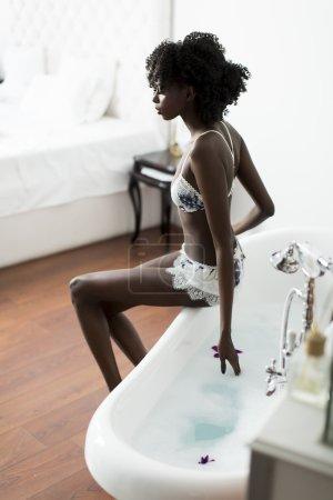 African american woman in bathroom