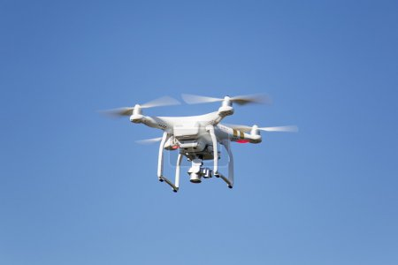 Photo for White drone hovering in the sky - Royalty Free Image