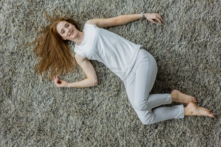 Woman lying on the carpet