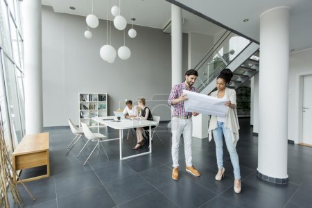 Photo for Young people working together in the office - Royalty Free Image
