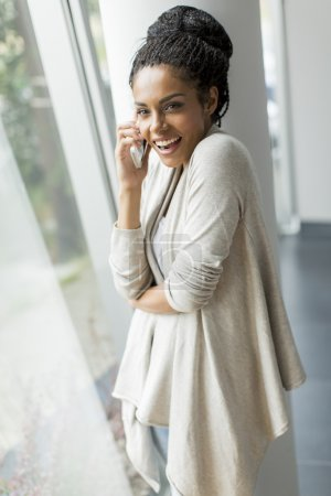 Pretty young woman talking on the phone