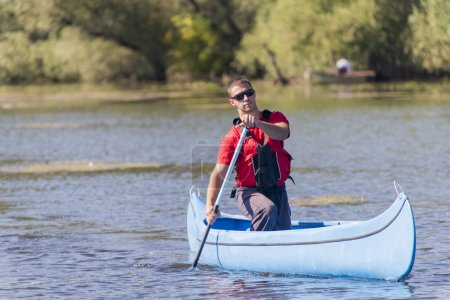Photo for Young man in canoe - Royalty Free Image