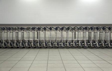 Metal trolleys in a store
