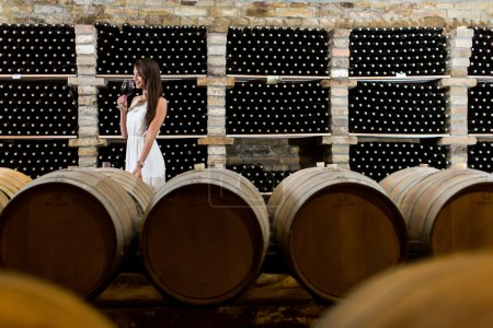 Woman in the wine cellar