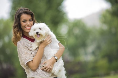 Woman with a maltese dog
