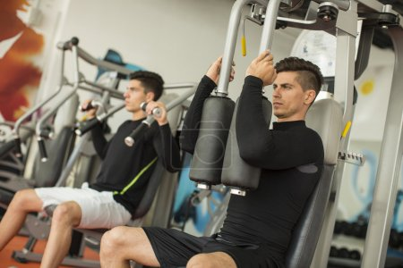 Men training in the gym