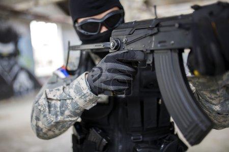 Armed man in uniform