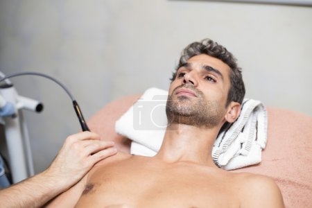 Male patient at physiotherapy