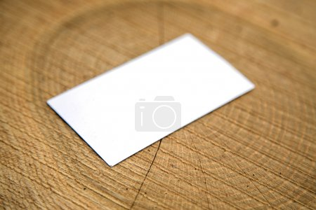 Blank business card on a wooden surface...