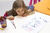 Girl drawing at playroom