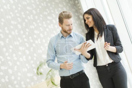 Photo for Young couple working in the office - Royalty Free Image